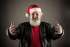 Funny mature man dressed as Santa Royalty Free Stock Images