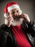 Funny mature man dressed as Santa Stock Image