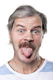 Funny mature man shows tongue isolated on white Stock Photos