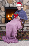 Funny Mature Senior Woman Mad Angry Christmas. A funny and humorous scene as a mature senior woman is mean, mad, angry, and scowls over her Christmas present stock photo