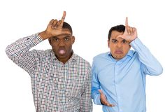 Funny men displaying loser sign Royalty Free Stock Photography