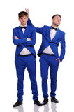 Funny men  dressed in blue suite Royalty Free Stock Photos