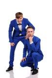 Funny men  dressed in blue suite Stock Photos