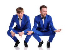 Funny men  dressed in blue suite Stock Image