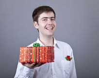 Funny men with gift. Royalty Free Stock Photos