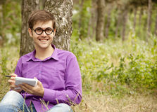 Funny men with glasses doing homework at the park Stock Photography