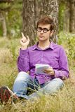 Funny men with glasses doing homework at the park Royalty Free Stock Photos