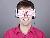 Funny men with notes and headphone. Royalty Free Stock Photography