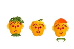Funny men's faces made of vegetables. Healthy eating. Funny men's faces made of vegetables and fruits with open-eyed Royalty Free Stock Images
