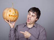 Funny men showing a pumpkin. Royalty Free Stock Image
