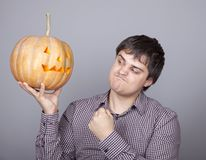 Funny men showing a pumpkin. Stock Images
