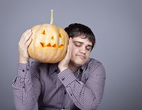 Funny men showing a pumpkin. Stock Photo