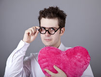 Funny men with toy heart. Royalty Free Stock Image