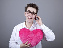 Funny men with toy heart. Royalty Free Stock Images