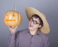 Funny men try to eat a pumpkin. Royalty Free Stock Photo