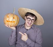 Funny men try to eat a pumpkin. Stock Photography