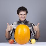 Funny men with two apples and one pumpkin. Royalty Free Stock Images