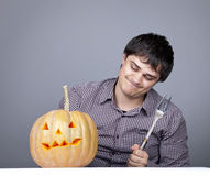 Funny Men With Fork Try To Eat A Pumpkin. Stock Images