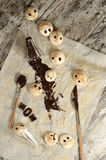 Funny meringue with chocolate on baking paper Stock Photos