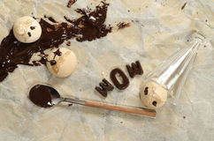 Funny meringue with chocolate on baking paper Royalty Free Stock Photography