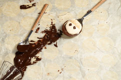 Funny meringue with chocolate on baking paper Stock Photography