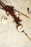 Funny meringue with chocolate on baking paper Royalty Free Stock Photo