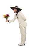 The funny mexican in suit holding flowers Royalty Free Stock Photography