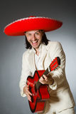 The funny mexican in suit holding guitar against Royalty Free Stock Photography