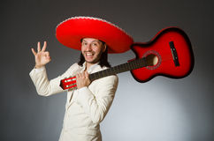 The funny mexican in suit holding guitar against Stock Images