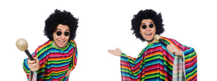 The funny mexican wearing poncho with maracas isolated on white. Funny mexican wearing poncho with maracas isolated on white stock images