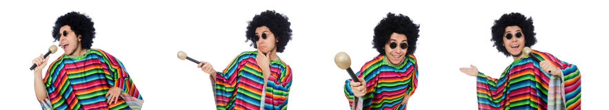 The funny mexican wearing poncho with maracas isolated on white. Funny mexican wearing poncho with maracas isolated on white royalty free stock photos