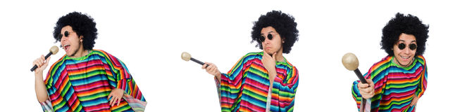 The funny mexican wearing poncho with maracas isolated on white. Funny mexican wearing poncho with maracas isolated on white stock image