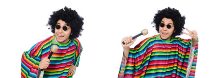 The funny mexican wearing poncho with maracas isolated on white. Funny mexican wearing poncho with maracas isolated on white stock photos