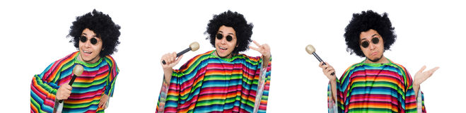 The funny mexican wearing poncho with maracas isolated on white. Funny mexican wearing poncho with maracas isolated on white stock photo