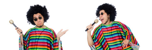 The funny mexican wearing poncho with maracas isolated on white. Funny mexican wearing poncho with maracas isolated on white royalty free stock photo