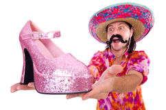 The funny mexican with woman shoe on white Stock Photo