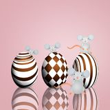 Funny mice with chocolate eggs Royalty Free Stock Photo