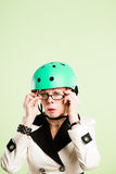 Funny woman wearing cycling helmet portrait pink background real Royalty Free Stock Photo