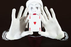 Funny mime holding a ace of hearts Stock Images