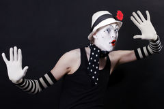 Funny mime in white hat with red flower Stock Photo