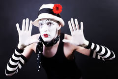 Funny mime in white hat with red flower Stock Photos
