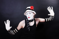 Funny mime in white hat with red flower Royalty Free Stock Photo