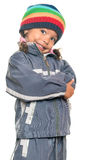 Funny mixed race little girl isolated on white. Funny mixed race little girl wearing a colorful beanie hat and a jacket with an attitude isolated on white stock photo