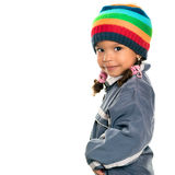Funny mixed race small girl wearing winter clothes Royalty Free Stock Photos