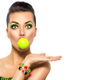 Funny model girl with green bubble of chewing gum Royalty Free Stock Images