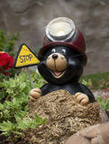 Funny mole figure with sign STOP Stock Image