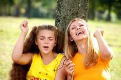 Funny Mom And Daughter Listening Music Stock Photos