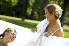 Funny mom and daughter hanging clothes Stock Photo