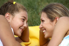 Funny mom and daughter smiling Stock Photo