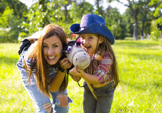 Funny mom and daughter and toy horse Royalty Free Stock Images